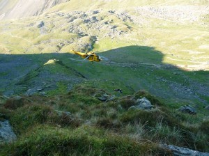 Casualty site is directly above a 500ft drop and in an extremely hazardous area. Hollow Stones in the background. helicopter coming in to drop off the team doctor by winch.
