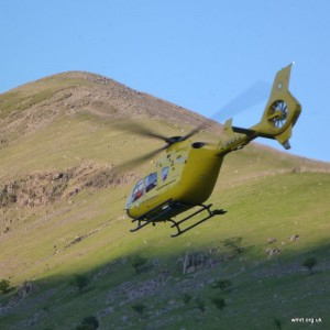 The air ambulance taking off in front of Lingmell Nose