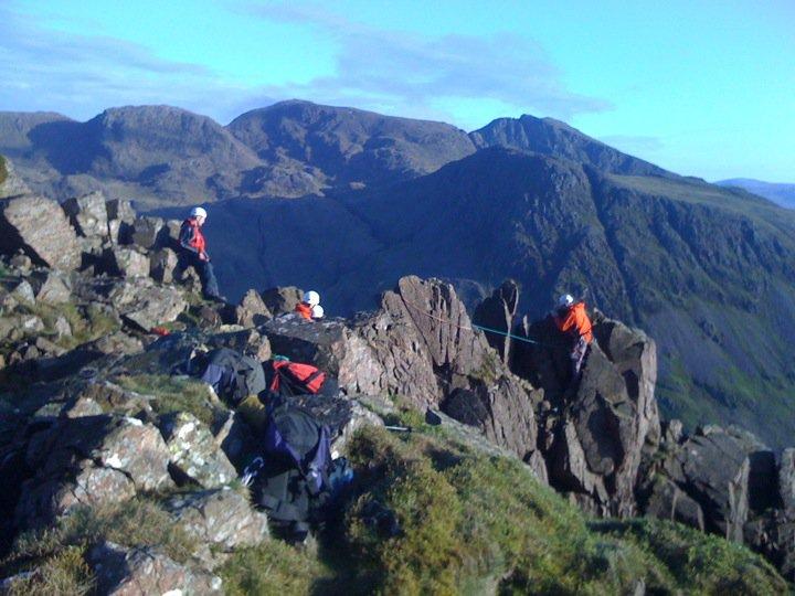 Team members at the top of Needle Ridge