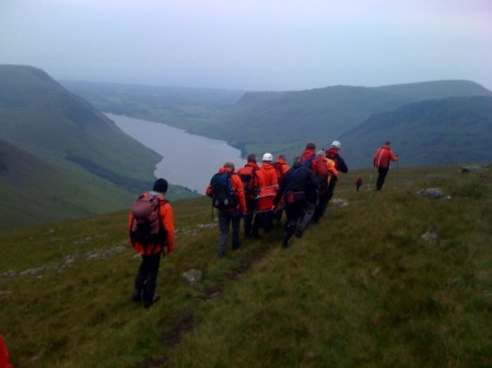 Carrying the stretcher across to Lingmell Nose