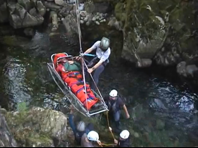 Stretcher and casualty being hoisted out of the gorge