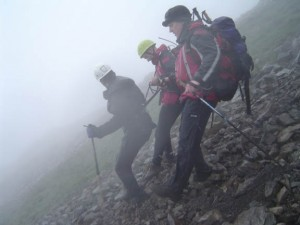 Cragfast walker is assisted off the scree by use of climbing harness and tapes