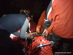 The casualty is given a last check by one of the team doctors before the descent begins