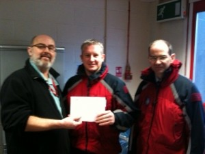 Mike and Paul receiving the donation from the B500 team