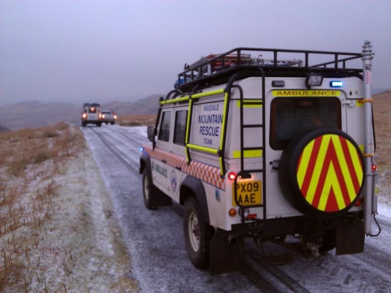 The two team landrovers on the Birker Fell road