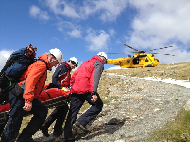 Carrying one of the casualties up to the waiting RAF Sea King