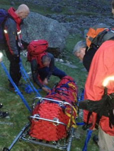 Stretcher loaded, last minute checks before the descent