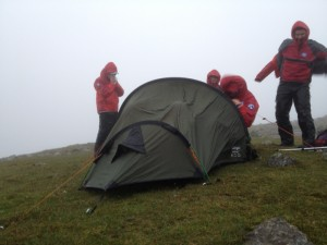 Team members outside the casualties' tent