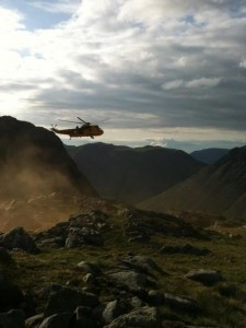 Smoke indicating the wind direction for the Sea King returning to pick up the casualty and team members from Scafell Pike