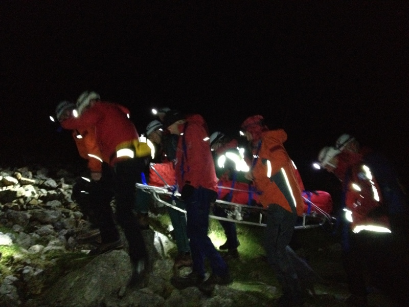 The casualty is moved to a better location for the helicopter to winch