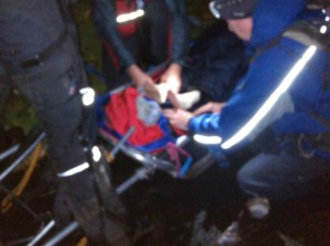 The casualty's ankles being checked out at Wasdale Head