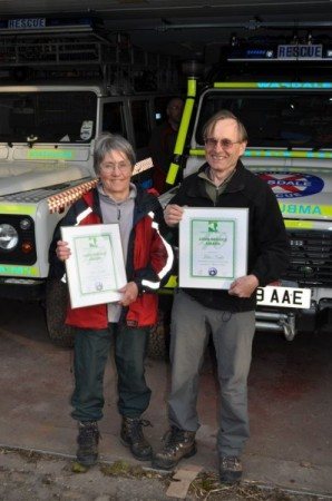 John and Sue with their certificates